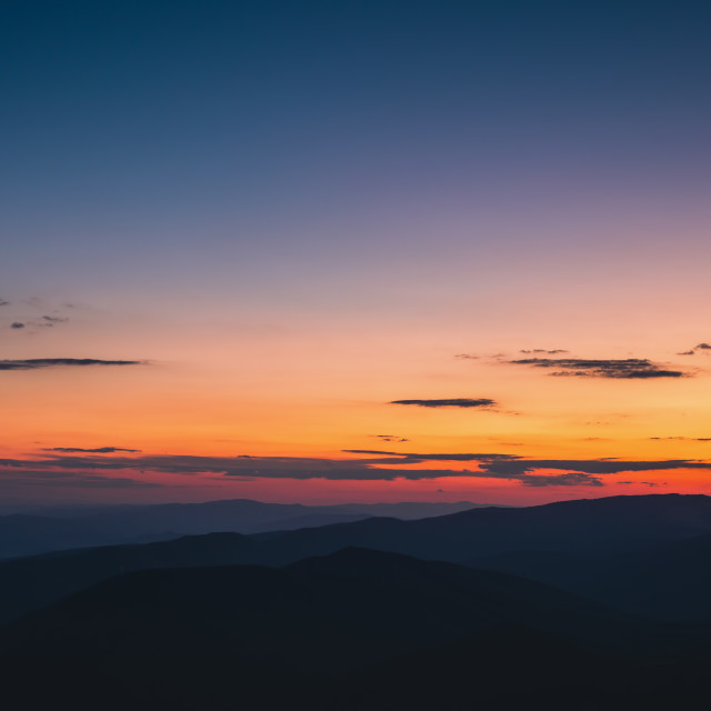 """""""Colorful sunset with the moon over the mountains, beautiful pano"""" stock image"""