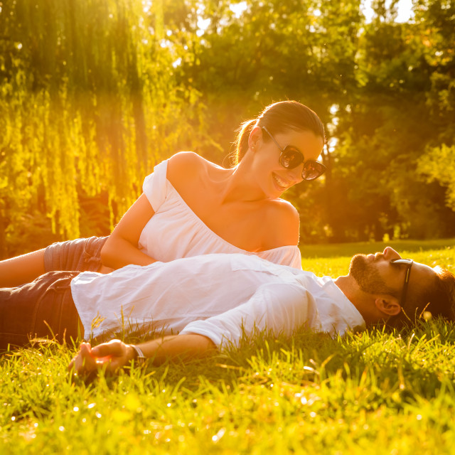 """Nice young couple in the park"" stock image"