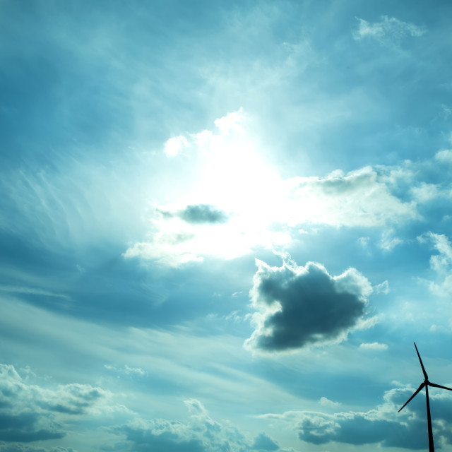 """Wind energy under a dramatic sky"" stock image"