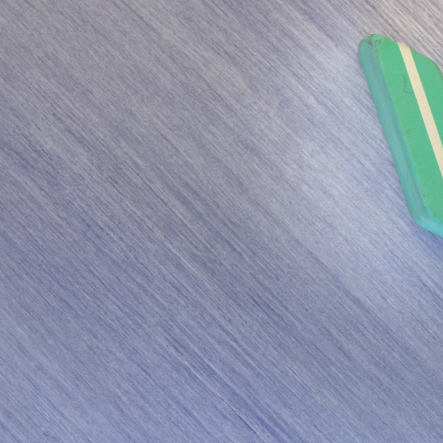 """""""green eraser on a wooden surface"""" stock image"""