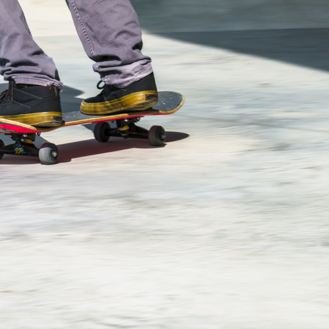 """Skateboard in top corner"" stock image"