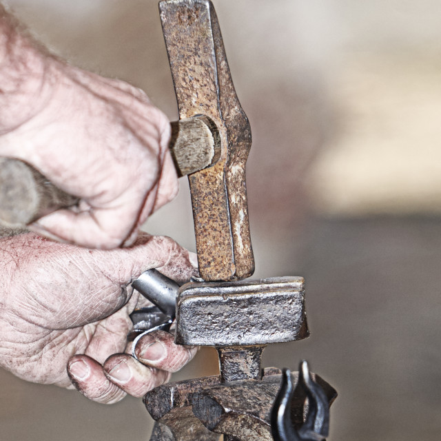 """blacksmith hammering"" stock image"