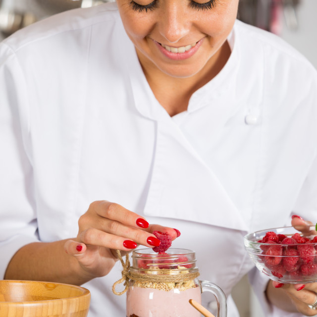 """""""Cook making a dessert"""" stock image"""
