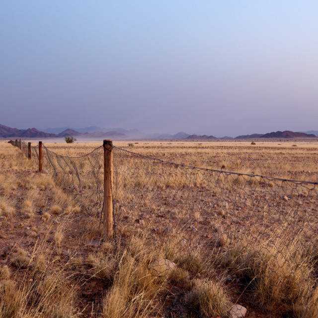 """Namibian landscape with a fence"" stock image"