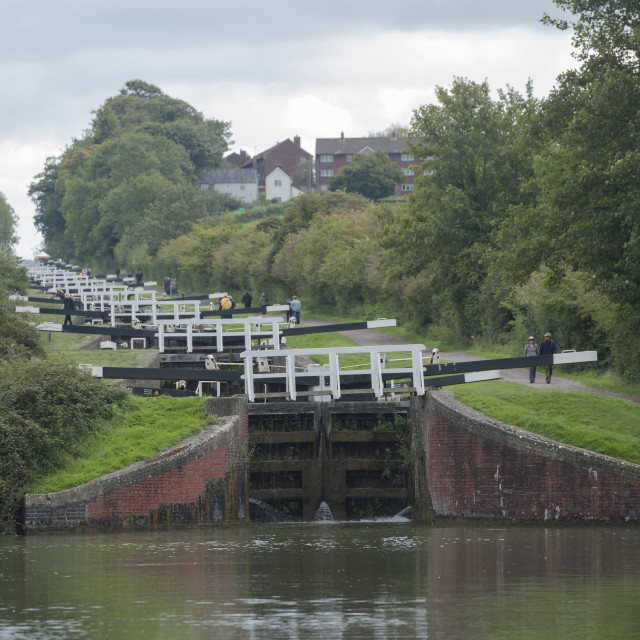 """""""Devizes Wiltshire England UK Kennet and Avon Canal. A row of locks forming part of the Caen Hill locks. The 16 locks can take 5-6 hours to climb"""" stock image"""