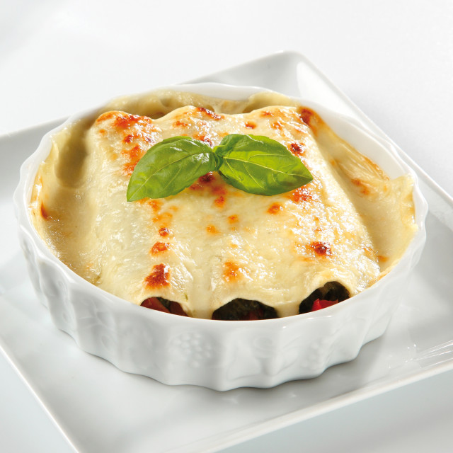 """""""Meat cannelloni with a bechamel sauce gratin"""" stock image"""