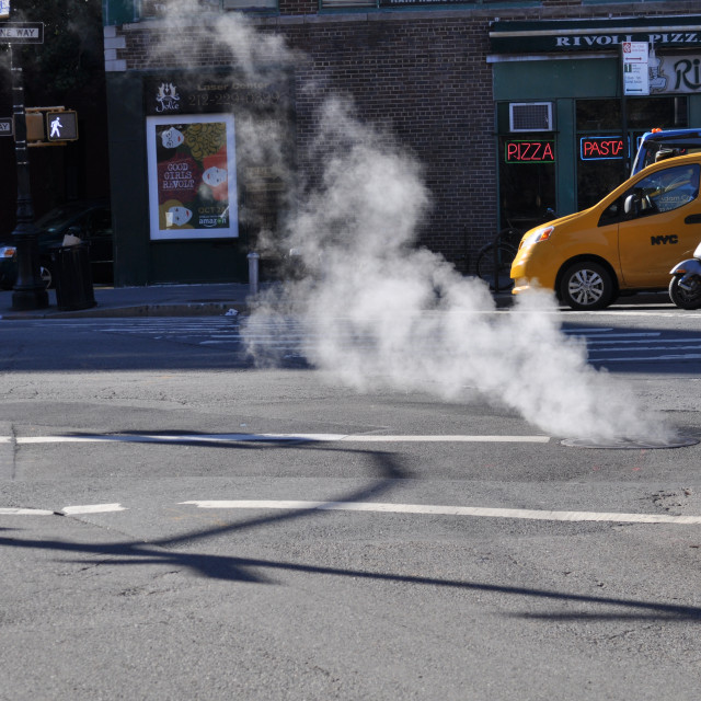 """Smoke from the cobblestones New York"" stock image"