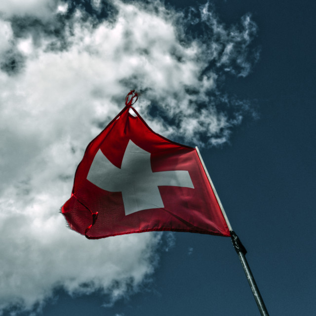 """Swiss Flag on blue"" stock image"