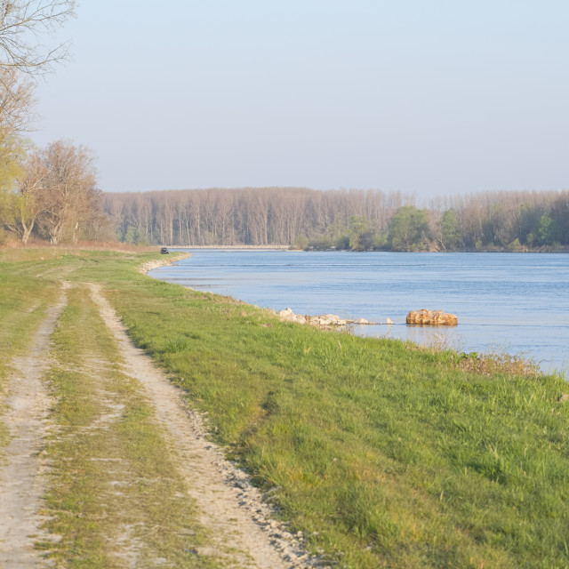 """Dirt Road on the River Bank"" stock image"