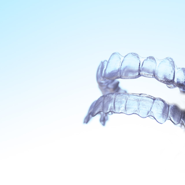 """Invisible dental orthodontics held by a woman"" stock image"