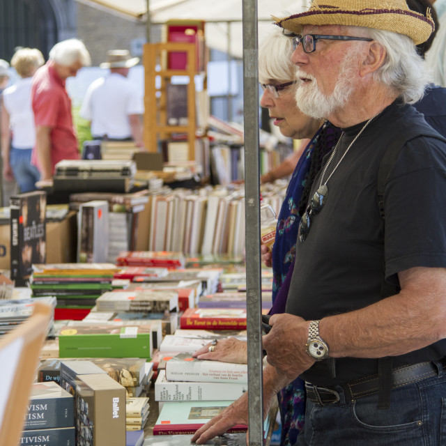 """""""Standing by the book stall"""" stock image"""