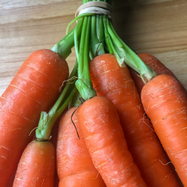 """Closeup view on a bunch of fresh carrots"" stock image"