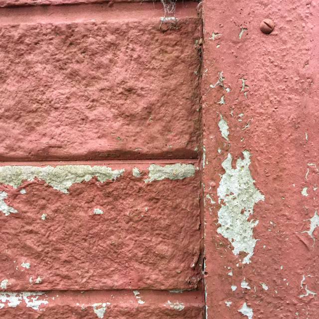 """Peeling paint on a concrete wall"" stock image"