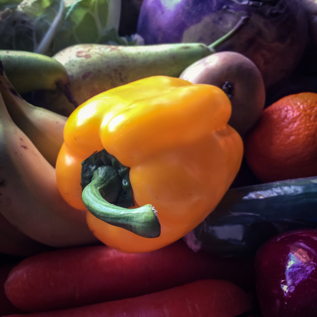 """Yellow bell pepper in a tray of seasonal fruit and vegetables"" stock image"
