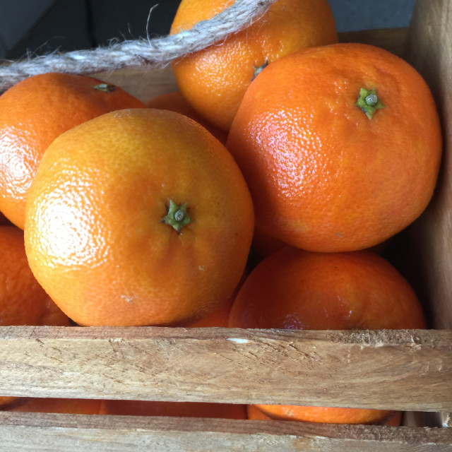 """Satsumas in a wooden crate"" stock image"