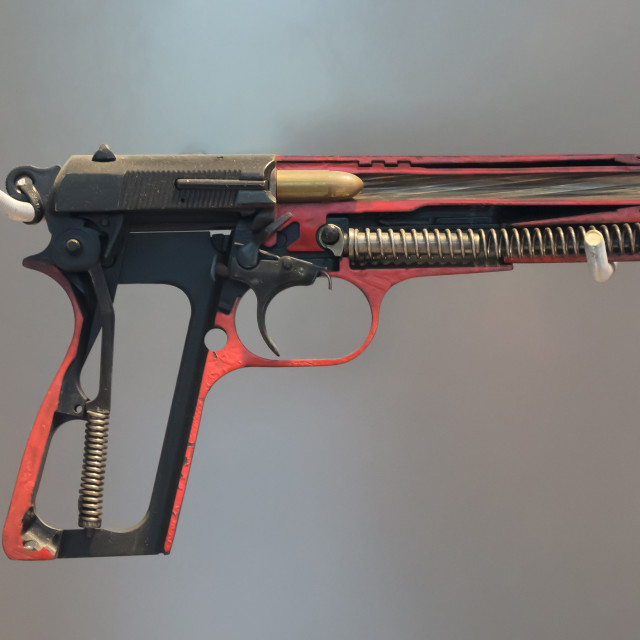 """Half metal 9mm pistol gun on solid background"" stock image"