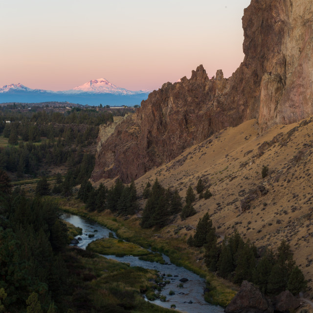 """Mountains Glow During Sunrise at Smith Rock State Park"" stock image"