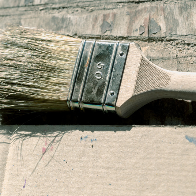 """Old, vintage, used paint brush on wooden table"" stock image"