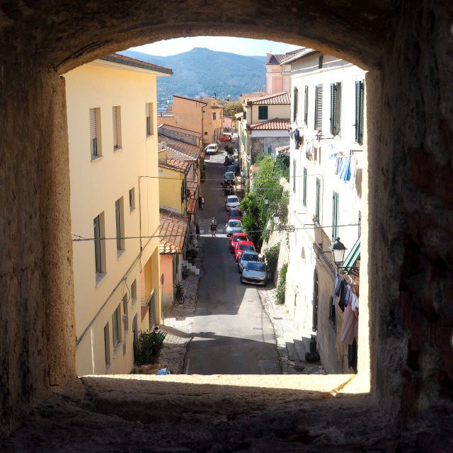 """A narrow street in the town of Portoferraio, Elba, Italy."" stock image"
