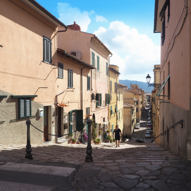 """A narrow street in Portoferraio, Elba, Italy"" stock image"