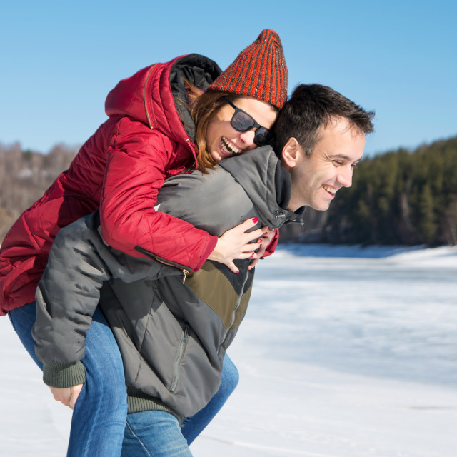 """Happy couple having fun on a frozen lake"" stock image"