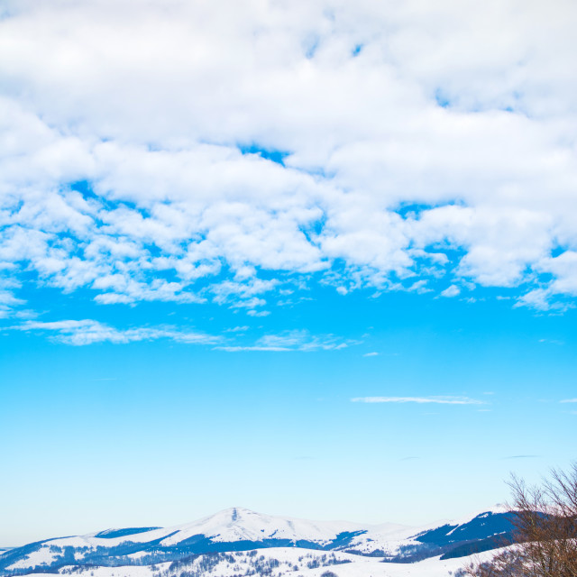 """Snow covered mountain and clear blue sky"" stock image"