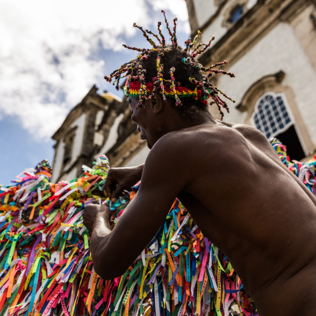 """""""Brazilian afro man making a wish with the colorful religious brazilian ribbons"""" stock image"""