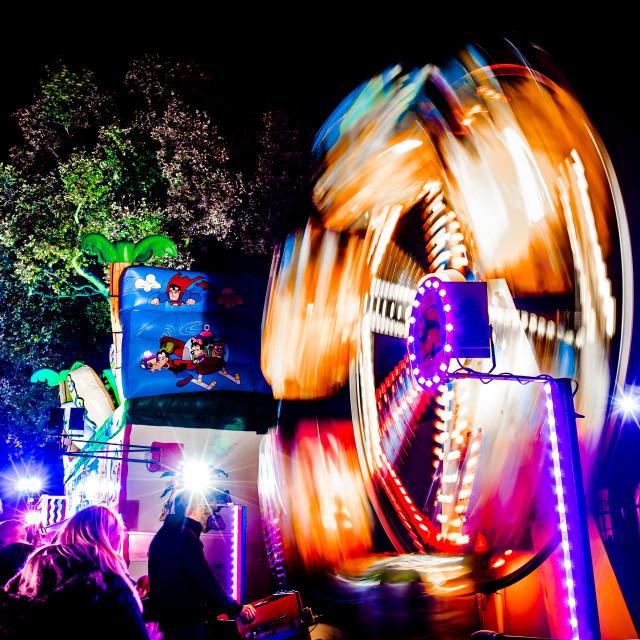 """Ferris Wheel blur at night"" stock image"