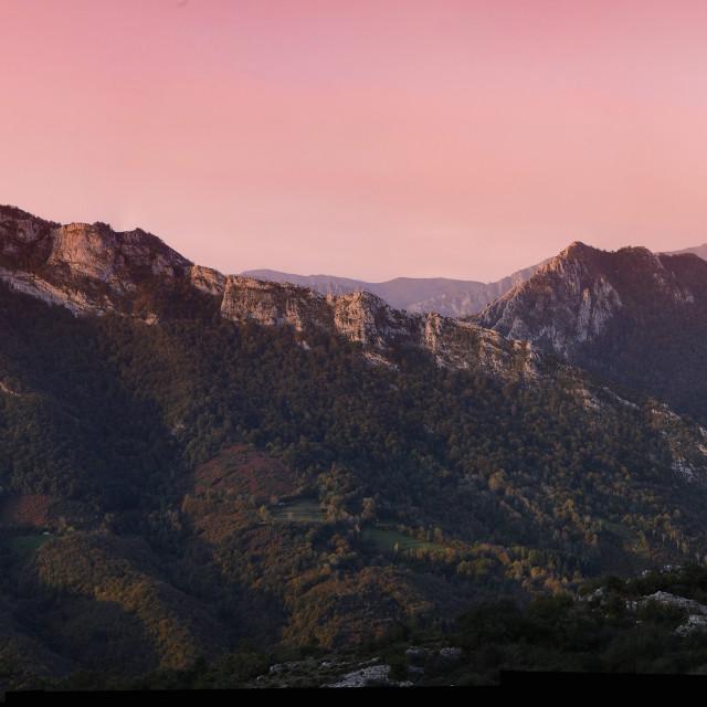 """Dawn over the village of Campo de Caso in Asturias."" stock image"