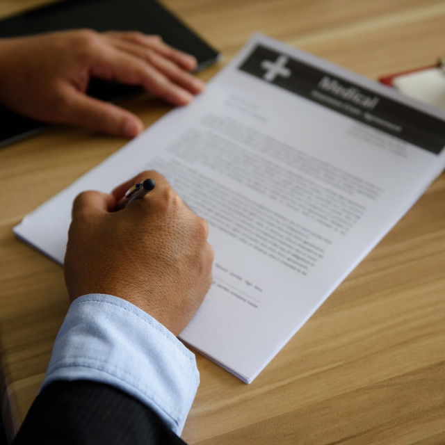 """Closeup hands of Businessman sign contract"" stock image"