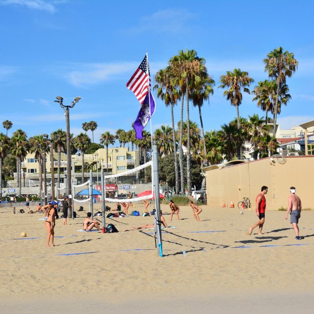 """People are playing beach volleyball at Santa Monica."" stock image"