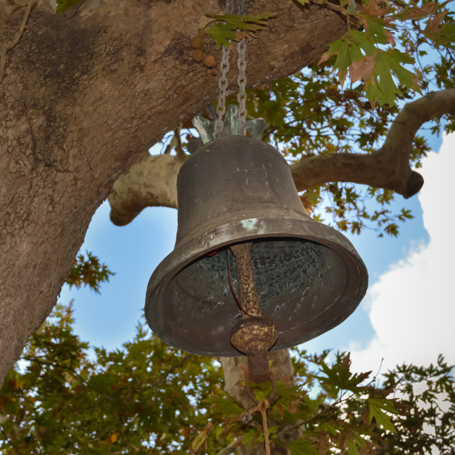 """""""Monastery bell hanging from an old"""" stock image"""