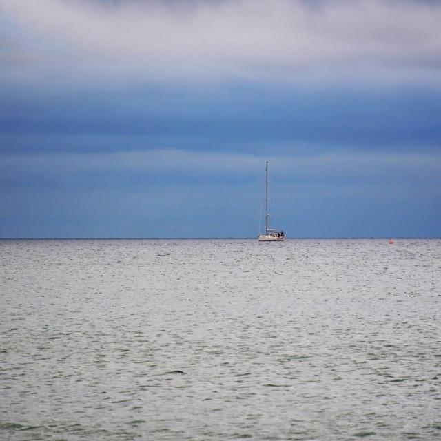 """Yacht on the Horizon"" stock image"