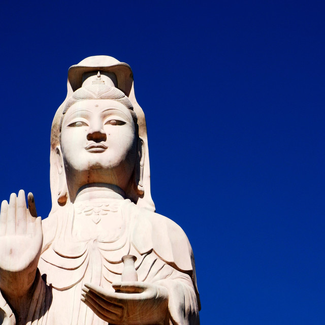 """Goddess of Mercy Kwan Yin soaring into blue sky"" stock image"