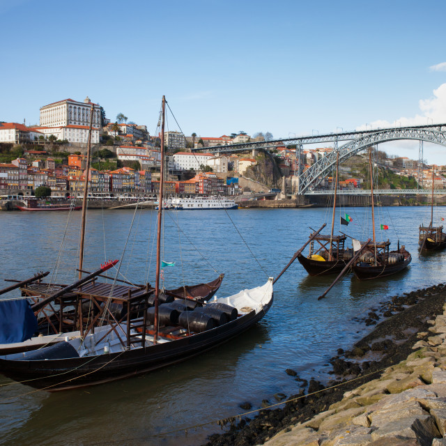 """Boats on Douro River and Porto Skyline in Portugal"" stock image"