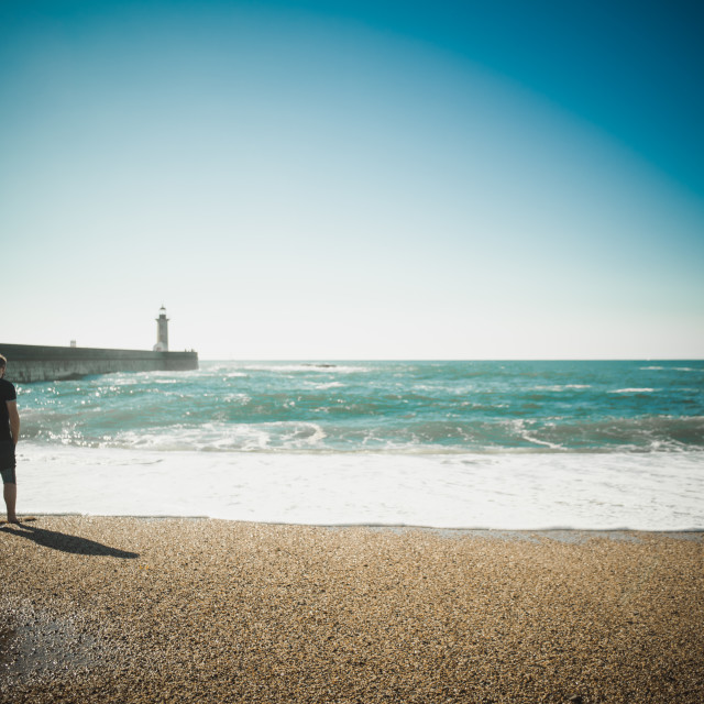 """man looking at the ocean"" stock image"