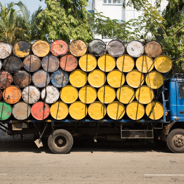 """Truck loaded with empty yellow and colorful oil barrels in Kochi, South India."" stock image"