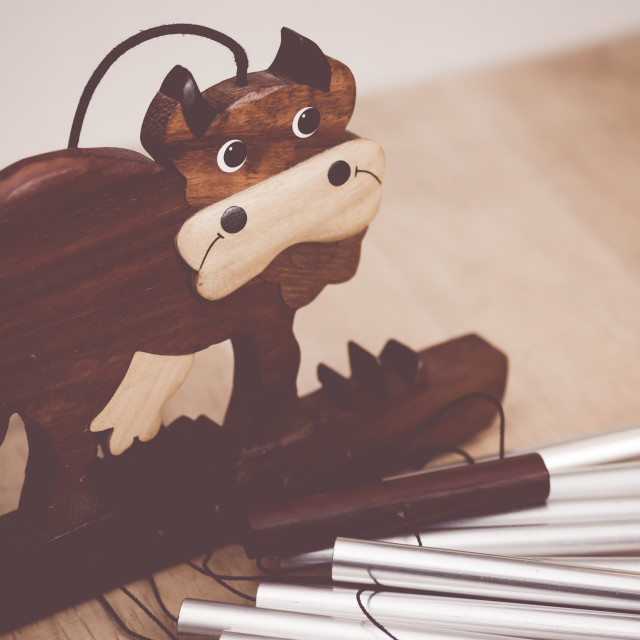 """hand made wood toys - wooden cow mobile"" stock image"