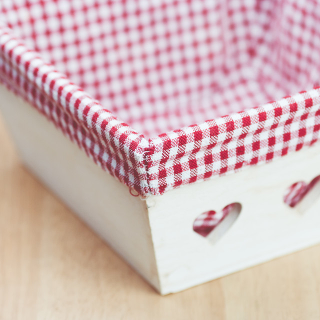 """wood basket with checkered fabric lining"" stock image"