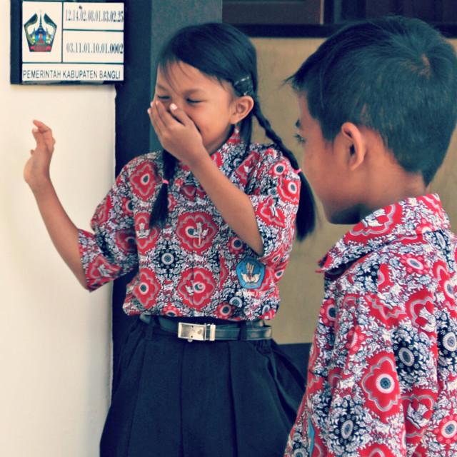 """""""Balinese schoolgirl laughing"""" stock image"""