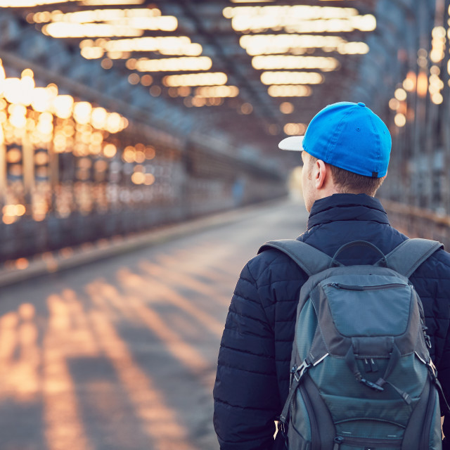 """Tourist on the old iron bridge"" stock image"