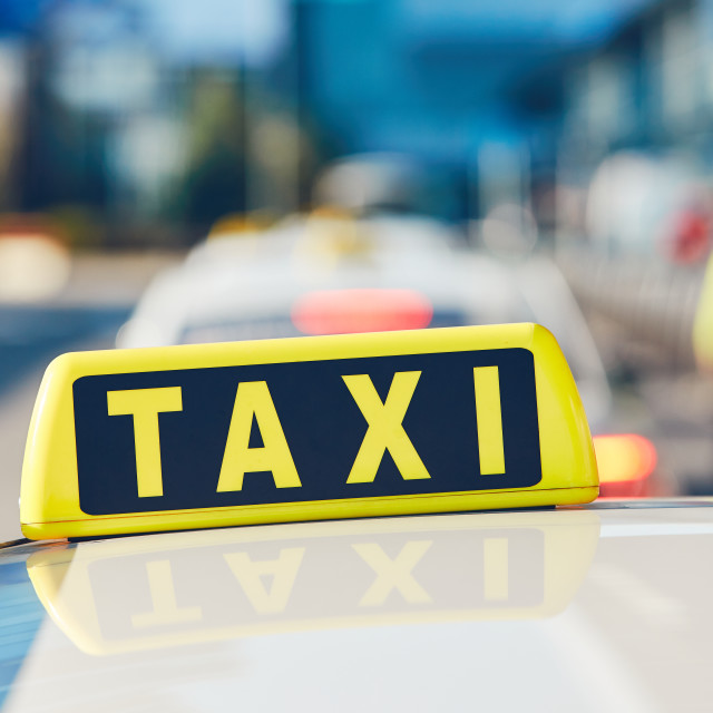 """Taxi cars on the street"" stock image"