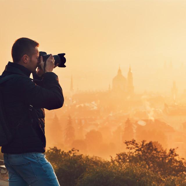 """Photographer at the sunrise"" stock image"