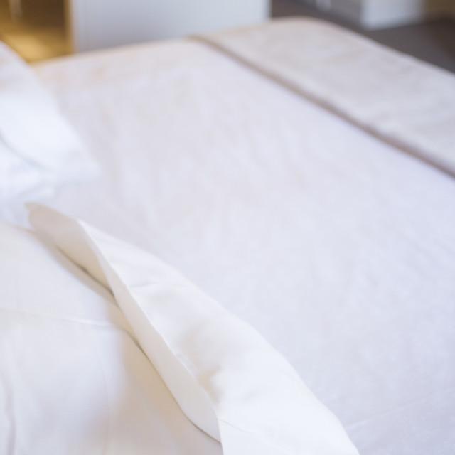 """Luxury hotel bedroom bed"" stock image"