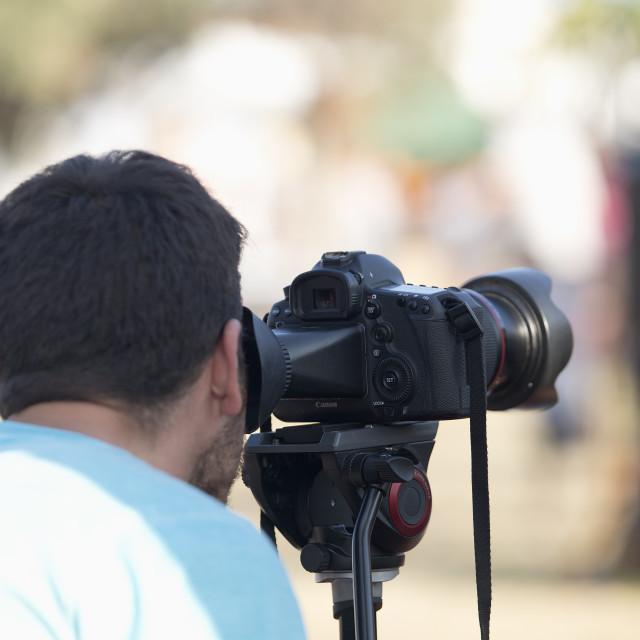 """Camera operator filming at Ecoaltea."" stock image"