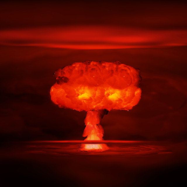 """Atomic bomb realistic explosion, red color with smoke on black background"" stock image"