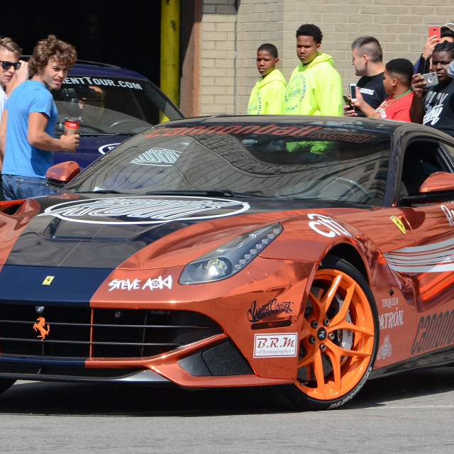 """A Wrapped Ferrari Starts Cannonball Run in Detroit"" stock image"
