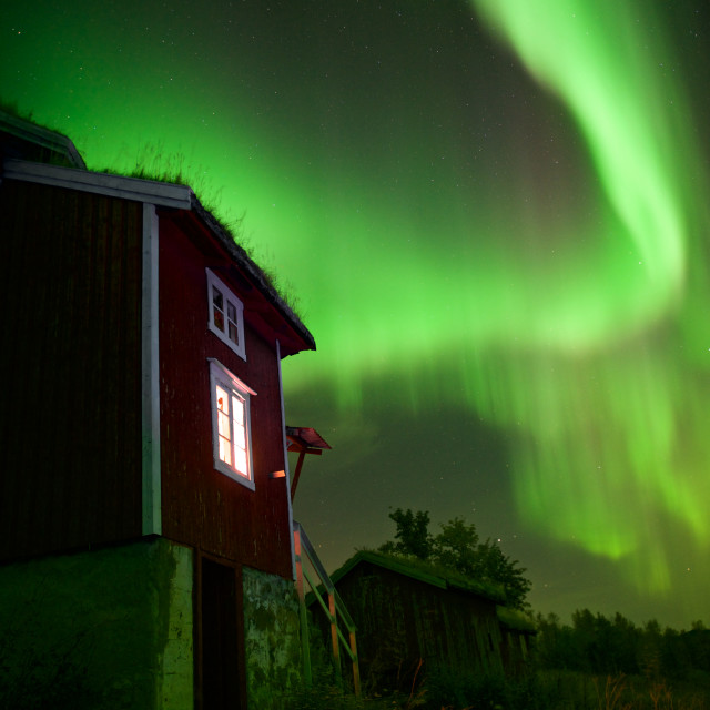 """Northern Lights over house"" stock image"
