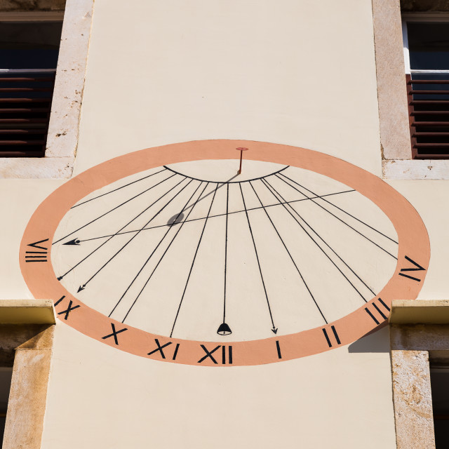 """""""Sun dial on a wall in Hvar Town"""" stock image"""