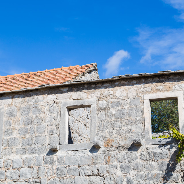 """Missing windows and roof on a building at Donja Nakovana"" stock image"